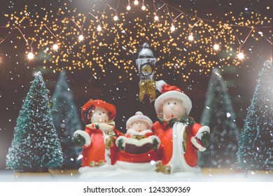 Christmas caroling or Carolers singing outside with snows.Family group singing carol song on celebration of christmas day in winter time.