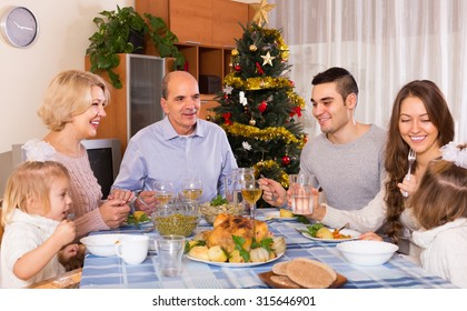 Christmas celebration in the bosom of happy family at home