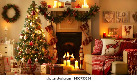 Christmas celebration at home, festive atmosphere: fireplace, candles, Christmas tree, gifts.