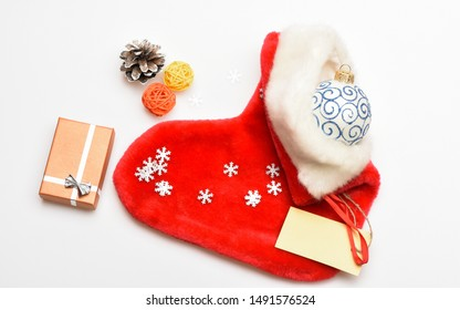 Christmas celebration. Christmas sock white background top view. Small items stocking stuffers or fillers little christmas gifts. Fill sock with gifts or presents. Contents of christmas stocking.
