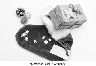 Christmas celebration. Christmas sock white background top view. Fill sock with gifts or presents. Small items stocking stuffers or fillers little christmas gifts. Contents of christmas stocking.