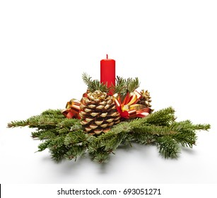 Christmas centerpiece decoration with a red color candle and fir tree leaves.
