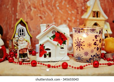 Christmas ceramic houses, Santa Clause and candle