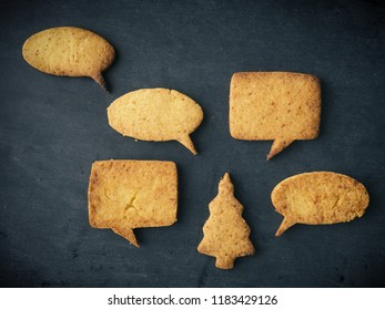 Christmas chat, Tasty homemade cookies on a chalkboard, seasonal or Christmas background