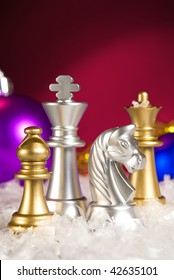 Christmas chess and snow on a dark background