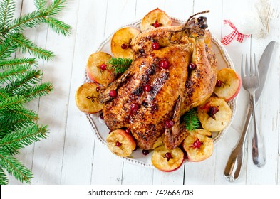 Christmas chicken (turkey) with apples and cranberries