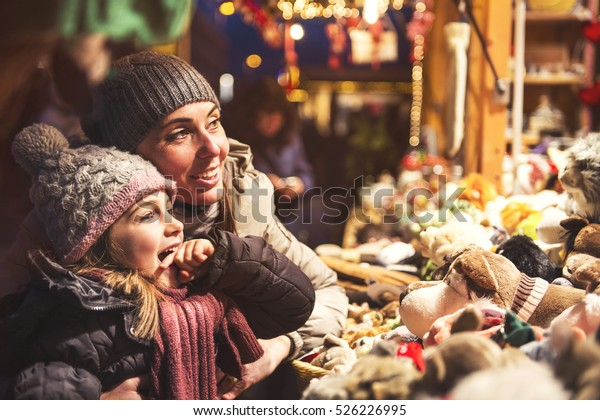 Christmas child is looking for a christmas present with the dear mother