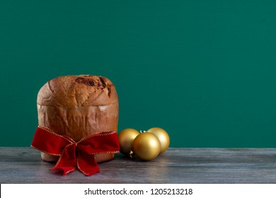 Christmas chocolate cake panettone with a red ribbon in a chroma background with ornament or panetone chocotone