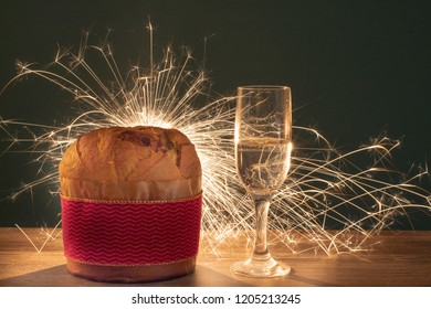 Christmas chocolate cake panettone with a red ribbon in new year background or panetone chocotone