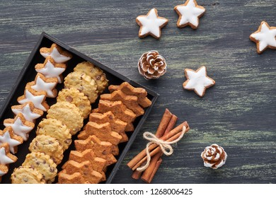 Christmas chocolate chip cookies, flat lay with spices and winter decorations on dark rustic wood