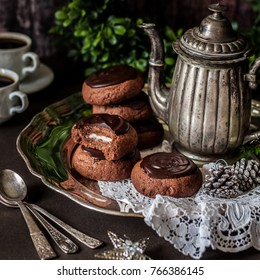 Christmas Chocolate and Mint Cookies Topped with Melted Chocolate on a Vintage Tray with an Antique Coffee Pot, square