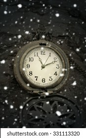 Christmas clock and falling snow