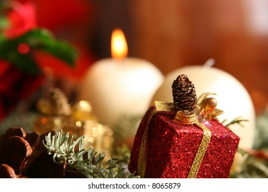 Christmas close up with one burning candle