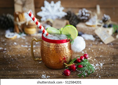 Christmas cocktail Moscow Mule on  wooden background