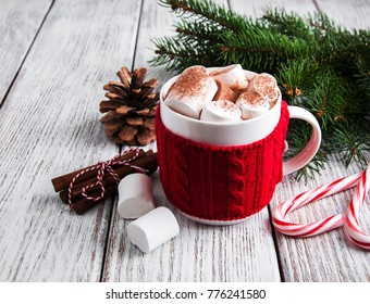 Christmas cocoa with marshmallow on a old wooden table