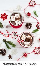 Christmas cocoa two cups and Christmas decorations snowflakes on a white wooden background