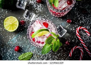 Christmas cold drink, Cranberry  Mojito cocktail with xmas decoration copy space white marble background