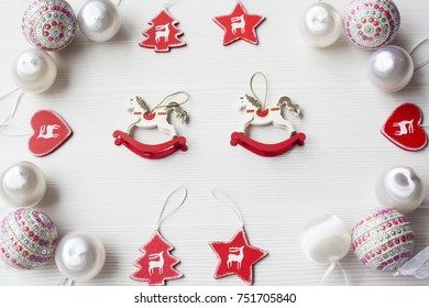 Christmas collection, decorative ornaments, on wood background.