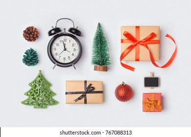 Christmas collection with gift boxes, alarm clock, pine tree and decorations. View from above. Flat lay