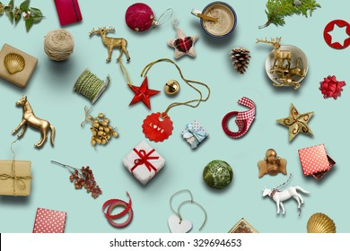 Christmas collection, gifts and decorative ornaments, on blue background. photographic montage