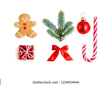 Christmas collection with gifts, fir tree, gingerbread man cookie and  ornaments isolated on white background close up. Flat lay, top view
