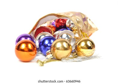 Christmas colorful balls in golden bag, on white