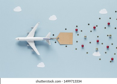 Christmas composition. Airplane fly label tag top view background with copy space for your text. Flat lay.