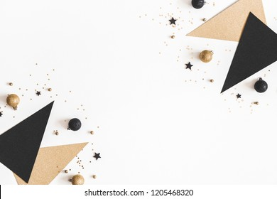 Christmas composition. Black and golden decorations on white background. Christmas, winter, new year concept. Flat lay, top view, copy space