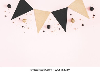 Christmas composition. Black and golden decorations on pastel pink background. Christmas, winter, new year concept. Flat lay, top view, copy space