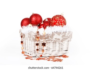 Christmas composition, the bright red balls in the basket