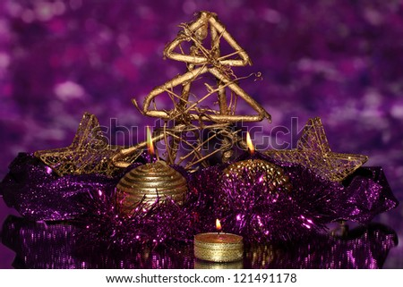 christmas composition with candles and decorations in purple and gold colors on bright background - Purple And Gold Christmas Decorations