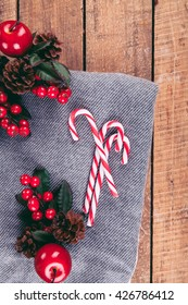Christmas composition with candy canes and a plaid