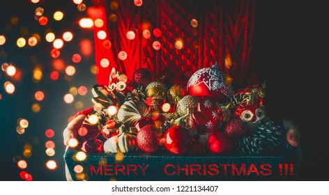 Christmas composition, Christmas decorations in the hands of a girl on the background of garlands, bokeh