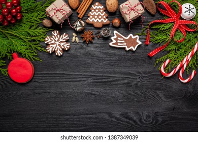 Christmas - composition with Christmas decorations on a black wooden background - space for text