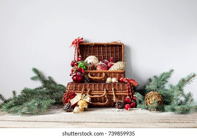 christmas composition christmas decorations in wicker baskets with fir tree branches on wooden background - Christmas Basket Decorations