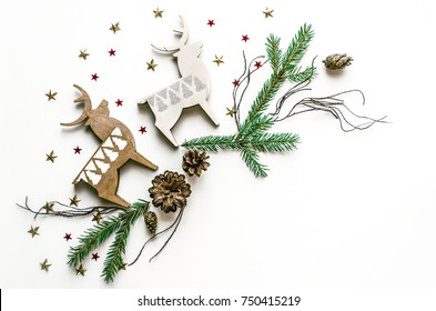 Christmas composition with deer, stars and fir branches. New Year background for presentation of work or text. Beautiful greeting card. Copy space.Top view