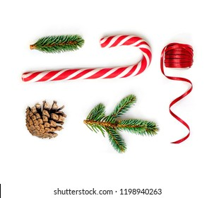 Christmas composition  with fir tree branches, red ribbon and Christmas Candy cane  on white background.  Flat lay. Top view