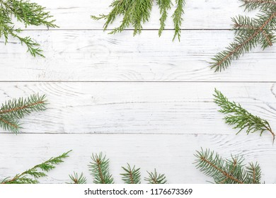 Christmas composition with frame of fir branches . Flat lay, top view