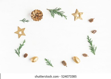 Christmas composition. Frame made of christmas decoration, cypress branches, pine cones. Flat lay, top view, copy space