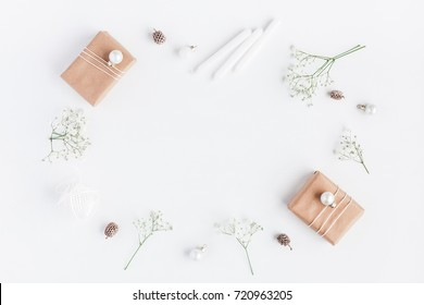 Christmas composition. Frame made of christmas gifts, pine cones, gypsophila flowers on white background. Flat lay, top view, copy space