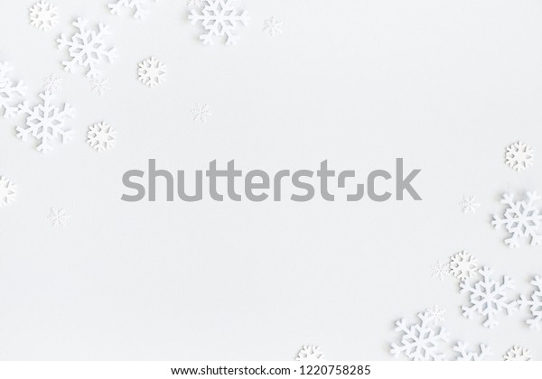 Christmas composition. Christmas frame made of snowflakes on pastel gray background. Winter concept. Flat lay, top view, copy space