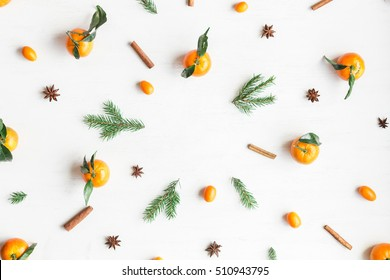Christmas composition. Christmas frame with tangerines, fir branches, cinnamon sticks, anise star. Flat lay, top view