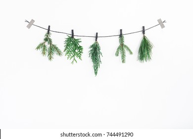Christmas composition. Christmas garland made of conifer tree branches on white background. Flat lay, top view, copy space.