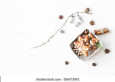 Christmas composition. Gift, larch branches, cinnamon sticks, anise star, christmas cookies. Flat lay, top view