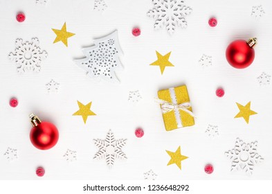 Christmas composition. Gift, red and white decorations on white background. Christmas, winter, new year concept. Flat lay, top view.