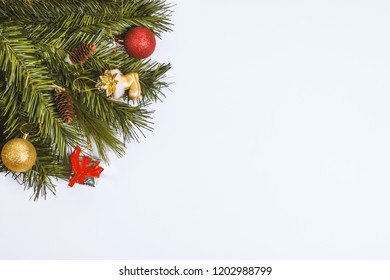 Christmas composition. Christmas gift, toy, pine cones and fir branches on  white background. Flat lay, top view.Copy space