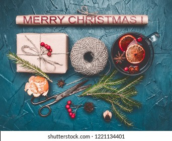 Christmas composition, gift, twine, mulled wine, on a blue background, top view