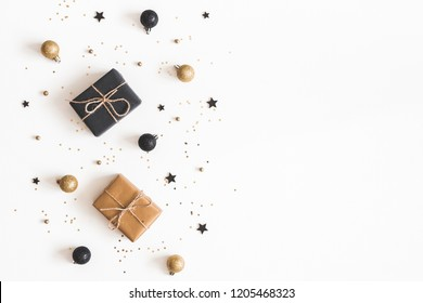 Christmas composition. Gifts, black and golden decorations on white background. Christmas, winter, new year concept. Flat lay, top view, copy space