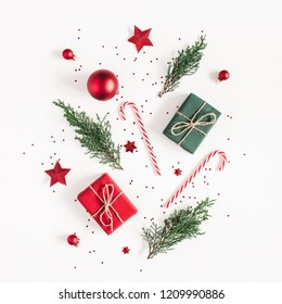Christmas composition. Gifts, fir tree branches, red decorations on white background. Christmas, winter, new year concept. Flat lay, top view, copy space, square