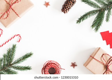 Christmas composition. Christmas gifts, fir tree branches, decorations on white background. Flat lay, top view, copy space